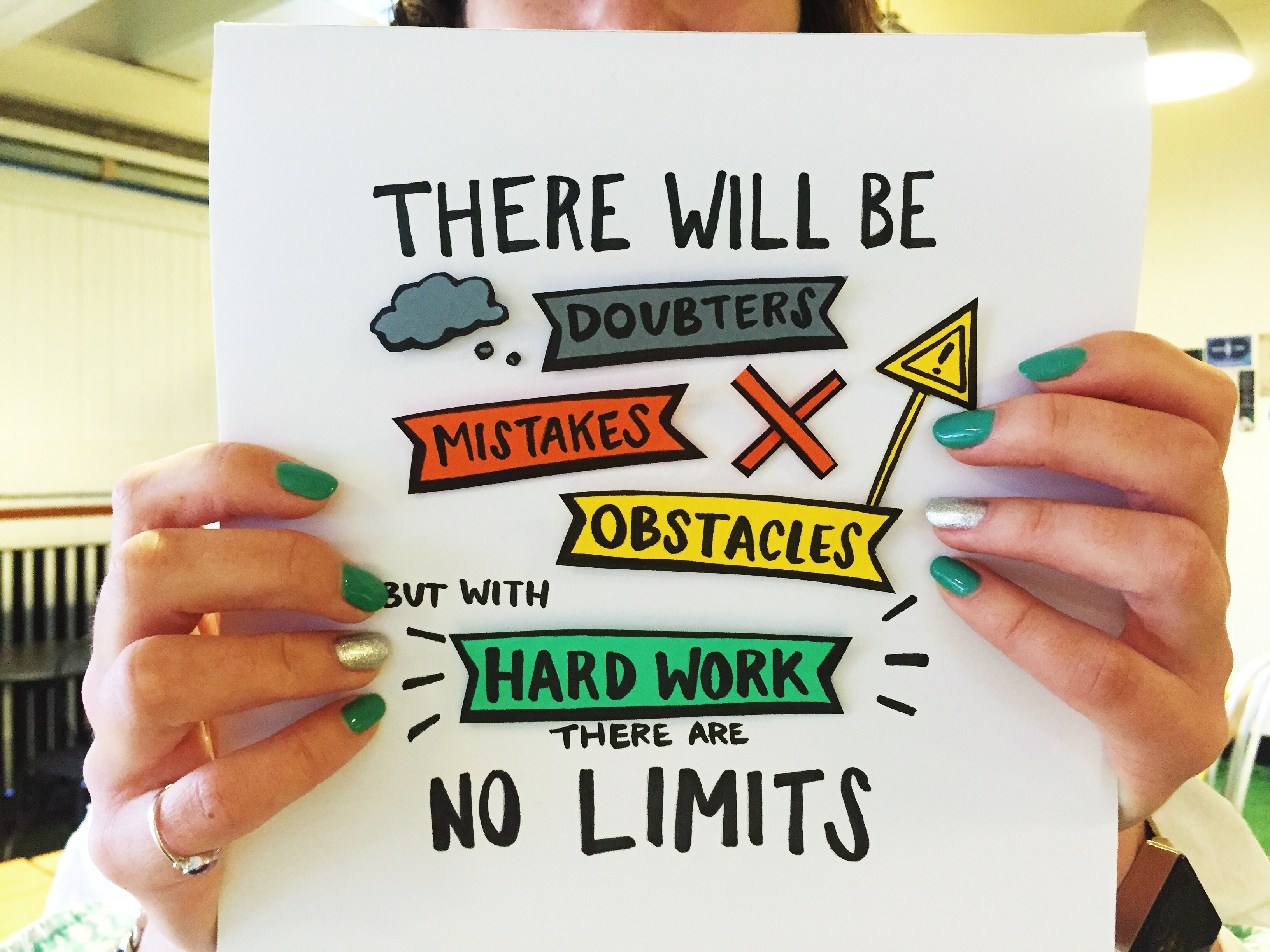 young-woman-with-green-and-golden-nail-polish-holding-motivational-poster-about-business-journey-of_t20_EOVbg4